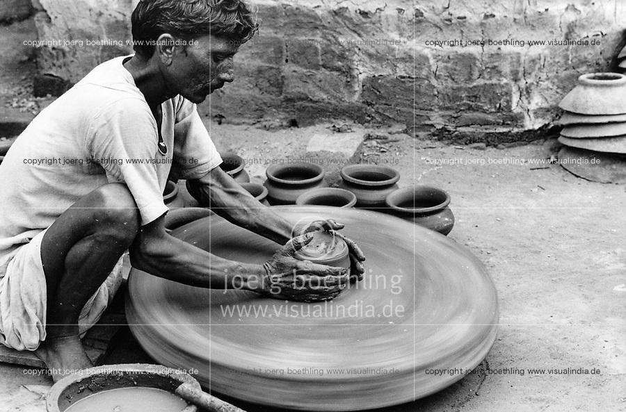 India, Narmada River, Narmada dams and protest movement of NBA Narmada Bachao Andolan, movement to save the Narmada river, and affected Adivasi in their villages, potter in village
