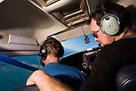Mountain Lion (Puma concolor) biologist, Paul Houghtaling, and pilot Mark Dedon, tracking mountain lions from airplane using telemtry, Santa Cruz Puma Project, Santa Cruz Mountains, California