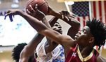 Lee's Evan Wiley (0) and Columbia's Jhontavious King (2). 2015 Huntsville Times Classic basketball tournament quarter-final game. Lee vs. Columbia at Huntsville High School. (Bob Gathany/bgathany@AL.com)