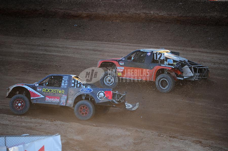 Dec. 10, 2011; Chandler, AZ, USA;  LOORRS pro 2 unlimited driver Brian Deegan (38) and Myan Spaccarelli (12) during round 15 at Firebird International Raceway. Mandatory Credit: Mark J. Rebilas-