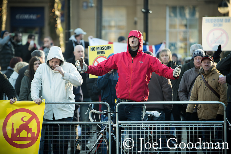 "© Joel Goodman - 07973 332324 . 26/11/2016 . Bolton , UK . Those opposed to mosques , pictured at the demonstration . Approximately 100 people attend a demonstration against the construction of mosques in Bolton , under the banner "" No More Mosques "" , organised by a coalition of far-right organisations and approximately 150 anti fascists opposing the demonstration , in Victoria Square in Bolton Town Centre . Photo credit : Joel Goodman"