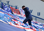 21.02.2021 Rangers v Dundee Utd: Injured captain James Tavernier walks up the stand to exit after the game