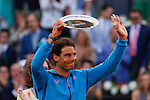 Rafael Nadal of Spain holds his runners up trophy after losing to Andy Murray of Britain during the men's final at the Madrid Open Tennis tournament in Madrid, Spain. May 10, 2015. (ALTERPHOTOS/Victor Blanco)