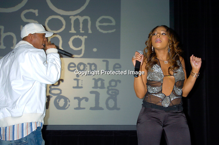 Ashanti singing with Ja Rule ..at the Do Something Brick Awards on April 8, 2004 at the ..Metropolitan Pavillion...Photo by Robin Platzer, Twin Images