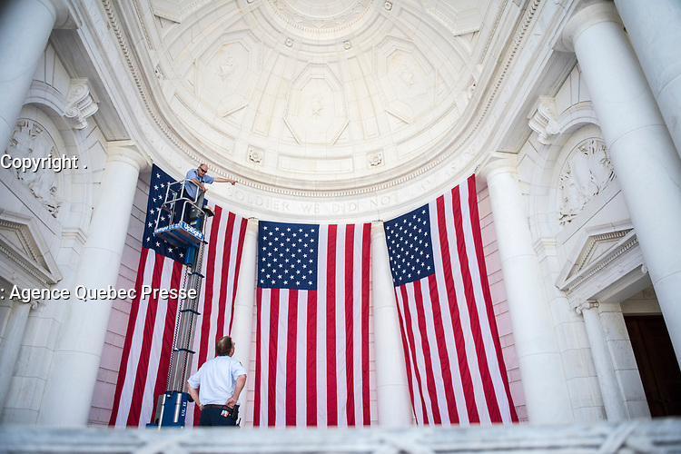 Dan Frye (top left), facilities maintenance electrian, Arlington National Cemetery; and Ray Coppage (lower center), facilities maintenance mechanic work lead, Arlington National Cemetery; hang American flags in the Memorial Amphitheater in preparation for Memorial Day at Arlington National Cemetery, Arlington, Virginia, May 21, 2018. 43 American flags are hung in the Memorial Amphitheater twice a year during observance of Memorial Day and Veterans Day (U.S. Army photo by Elizabeth Fraser / Arlington National Cemetery / released)