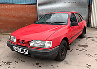 BNPS.co.uk (01202 558833)<br /> Pic: HampsonAuctions/BNPS<br /> <br /> Pictured: 1991 Ford Sierra LX Quartz.<br /> <br /> Since the 1990s, Geoff Barlow, 46, has collected dozens of classic cars from an Escort Mexico replica to several types of Transit, Cortina, and Sierra.<br /> <br /> However, he still regrets selling the first car which inspired his passion, a 1980 Escort Mark 2 he bought from his sister in 1992.  <br /> <br /> Geoff's fascination with Fords gathered pace in the last decade and he 'lost control,' buying as many Fords as he came across and saving them from disrepair.