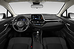 Stock photo of straight dashboard view of 2020 Toyota C-HR LE 5 Door SUV Dashboard