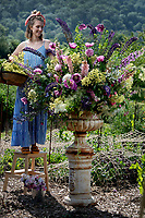 """BNPS.co.uk (01202 558833)<br /> Pic: ZacharyCulpin/BNPS<br /> <br /> Sula Jones celebrates the start of British Flowers Week with a stunning display of the seasonal flowers and foliages picked on her Somerset flower farm at Compton Dundon,<br /> <br /> Sula, who runs floral design studio and flower farm 'Nice Bunch' with her partner Oliver is a member of Flowers from the Farm, the membership association championing over 1000 artisan growers of seasonal, scented, sustainable British cut flowers."""""""