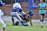 Asheville Tourists mascots Ted E Tourists and Mr. Moon have an on field altercation during a game against the West Virginia Power at McCormick Field on June 25, 2016 in Asheville, North Carolina. The Tourists defeated the Power 8-4. (Tony Farlow/Four Seam Images)
