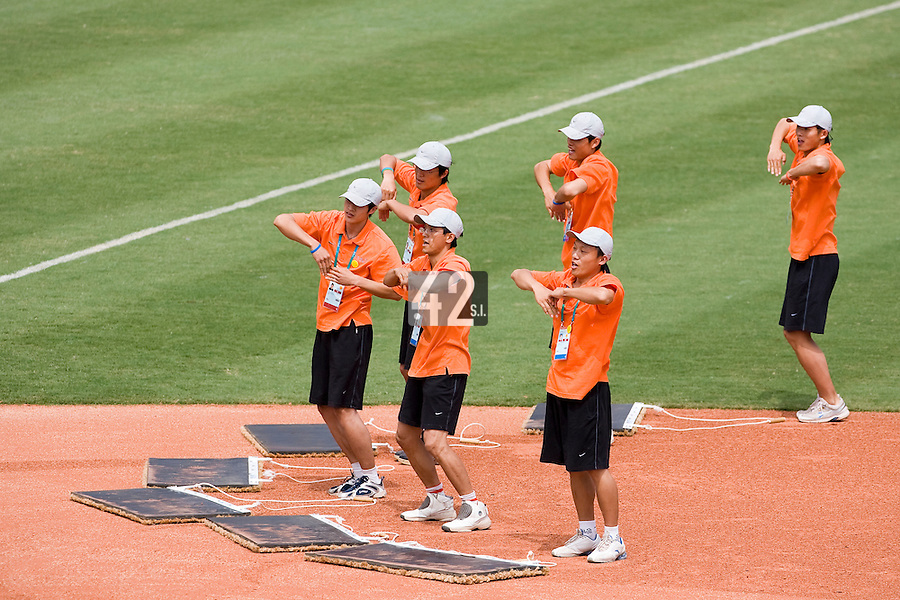22 August 2007: Chinese staff dance on the field during the Japan 9-4 victory over France in the Good Luck Beijing International baseball tournament (olympic test event) at west Beijng's Wukesong Baseball Field in Beijing, China.