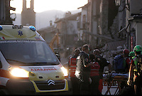 An ambulance past collapsed buildings in the village of Amatrice, central Italy, hit by a magnitude 6 earthquake at 3,36 am, 24 August 2016.<br /> Un'ambulanza tra gli edifici crollati dopo il terremoto che alle 3,36 del mattino ha colpito Amatrice, 24 agosto 2016.<br /> UPDATE IMAGES PRESS/Isabella Bonotto