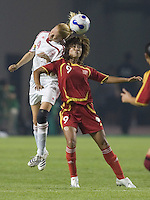 Denmark defender (4) Gitte Andersen goes up for a header aginst China forward (9) Han Duan during their first round game at the 2007 FIFA Women's World Cup at Wuhan Sports Center Stadium in Wuhan, China.  China defeated Denmark, 3-2.