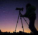 """06/08/18<br /> <br /> Ten-year-old Freya Kirkpatrick sets up a camera to capture an Iridium Flare visible over Derbyshire tonight - an event that may not be possible to see again from this autumn.<br /> <br /> She used an app on her ipad to predict the exact bearing, elevation and time to photograph the heavenly event.<br /> <br /> An Iridium Flare is when light is reflected off an Iridium satellite. All 66 of these old, low-orbit, communications satellites are all currently being de-orbited and tumbling back to earth (many have already done so) and are being replaced with new ones that will not reflect light in the same way. Many of these Iridium satellites will remain in an irregular decreasing orbit for years to come but their 'flares' will become harder to predict.<br /> <br /> Matt Desch, CEO of Iridium Communications said: """"By autumn 2018 we will not need any more of the original satellites.<br /> <br /> """"So in terms of satellites that are under our control and still predictably flare, the last one will be around the end of 2018.""""<br /> <br /> Tonight 'Iridium 95' was at 43 degrees in the north eastern sky at an elevation of 36 degrees and passed over Clifton, as predicted at exactly 22:51:20.<br /> <br /> <br />  <br /> All Rights Reserved: F Stop Press Ltd. +44(0)1335 344240  www.fstoppress.com www.rkpphotography.co.uk"""