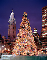 Philadelphia, Pennsylvania. City Hall Tower (L) is the backdrop for a Christmas tree on Franklin Parkway..