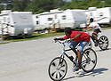 Two children ride bikes during a school day at Renaissance Village in Baker, Louisiana, May 19, 2006.