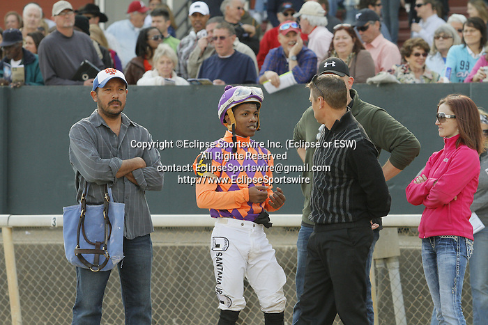 Jockey Ricardo Santana, Jr. talking over the race with the co-trainer Darren Flemming after an objection during the running of the Honeybee Stakes (Grade III) at Oaklawn Park in Hot Springs, Arkansas-USA on March 8, 2014. (Credit Image: © Justin Manning/Eclipse/ZUMAPRESS.com)