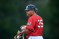 Billings Mustangs Hernan Iribarren (35) coaches first base during a Pioneer League game against the Grand Junction Rockies at Dehler Park on August 14, 2019 in Billings, Montana. Grand Junction defeated Billings 8-5. (Zachary Lucy/Four Seam Images)