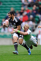 Sherwin Stowers of New Zealand is tackled by Philip Snyman of South Africa during Day Two of the iRB Marriott London Sevens at Twickenham on Sunday 11th May 2014 (Photo by Rob Munro)