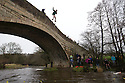 01/01/16<br /> <br /> After overnight temperatures plunged below zero, New Year's Day revellers jump off Mapleton bridge into the near freezing river Dove near Ashbourne in the Derbyshire Peak District. <br /> <br /> Notes: village name can be spelt either Mapleton or Mappleton.<br /> <br /> <br /> <br /> All Rights Reserved: F Stop Press Ltd. +44(0)1335 418365   www.fstoppress.com.