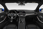 Stock photo of straight dashboard view of 2019 BMW 3-Series M-Sport 4 Door Sedan Dashboard
