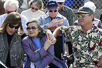 Maxine Eden is comforted by daughter Stacy Wilde (L) and son Jim Eden during a Memorial service held for Coach Bennie Eden at the Point Loma High School Football stadium that was recently renamed in his honor, Saturday February 23 2008.