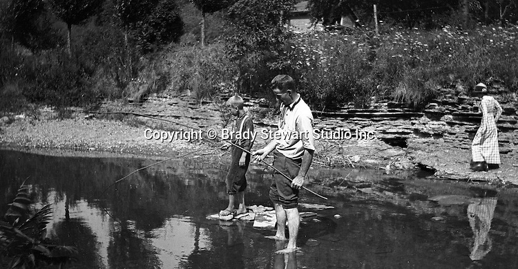 Erie PA:  Family fishing in the stream near Lake Erie.