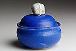 Hand made Blue Pottery Keepsake Jar with unusual stone handle.