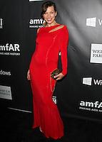 HOLLYWOOD, LOS ANGELES, CA, USA - OCTOBER 29: Milla Jovovich arrives at the 2014 amfAR LA Inspiration Gala at Milk Studios on October 29, 2014 in Hollywood, Los Angeles, California, United States. (Photo by Celebrity Monitor)