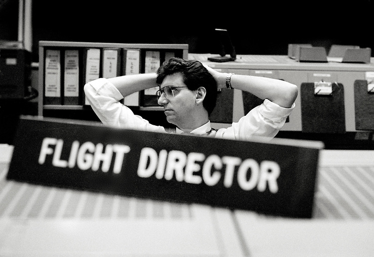 Image copyright John Angerson. <br /> STS-72 mission training.<br /> NASA STS-72 Flight Director Jeff Bantle. The flight director, simply known as 'Flight' was the ultimate supervisor of the Mission Control Center. He gave the final orbit entrance/exit, and, in emergencies, made mission abort decisions.<br /> Johnson Space Center Houston, Texas, USA.