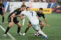 FOXBOROUGH, MA - AUGUST 4: Walker Zimmerman #25 of Los Angeles FC and Steven Beitashour #3 of Los Angeles FC double team Gustavo Bao #7 of New England Revolution during a game between Los Angeles FC and New England Revolution at Gillette Stadium on August 3, 2019 in Foxborough, Massachusetts.