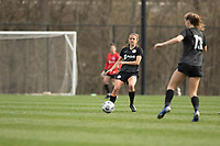 LOUISVILLE, KY - MARCH 13: Nealy Martin #36 passes the ball to teammate Emina Ekic #13 of Racing Louisville FC during a game between West Virginia University and Racing Louisville FC at Thurman Hutchins Park on March 13, 2021 in Louisville, Kentucky.