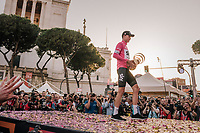 "Maglia Rosa / overall winner Chris Froome (GBR/SKY) walking off the final podium in Rome  with the enigmatic 'Trofeo Senza Fine' (""Never Ending Trophy"")<br /> <br /> stage 21: Roma - Roma (115km)<br /> 101th Giro d'Italia 2018"