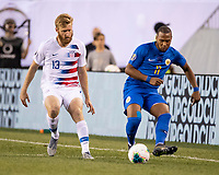PHILADELPHIA, PA - JUNE 30: Tim Ream #13 challenges Gevaro Nepomuceno #11 as he passes the ball during a game between Curaçao and USMNT at Lincoln Financial Field on June 30, 2019 in Philadelphia, Pennsylvania.