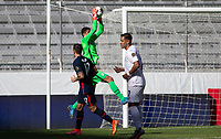 GUADALAJARA, MEXICO - MARCH 28: David Ochoa #20 of the United States jumps high for a save during a game between Honduras and USMNT U-23 at Estadio Jalisco on March 28, 2021 in Guadalajara, Mexico.
