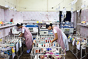 Nurses are seen giving medical care to the new born babies in the nursery of Duncan Hospital in Raxaul of East Champaran district of Bihar, India. Since 2008 the Foundation and Geneva Global have been investing in the training of medical staff to improve the lives of people living in 600+ villages in the region. The NGOs are delivering cost effective interventions to address treatment, care and prevention of diseases, disability and preventable deaths amongst infants, adolescent girls and women of child-bearing age. There is statistical and anecdotal evidence that there have been vast improvements and a total of 40-50% increased immunization for all children under 6 has meant that communities can be serviced and educated long term. Photograph: Sanjit Das/Panos for Legatum Foundation