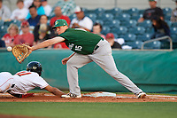 Daytona Tortugas first baseman Gavin LaValley (15) stretches for a throw as Ray-Patrick Didder (11) dives back to first base during a game against the Florida Fire Frogs on April 6, 2017 at Osceola County Stadium in Kissimmee, Florida.  Daytona defeated Florida 3-1.  (Mike Janes/Four Seam Images)