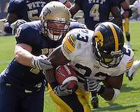September 20, 2008: Pitt linebacker Scott McKillop tackles Iowa running back Shonn Greene (23). The Pitt Panthers defeated the Iowa Hawkeyes 21-20 on September 20, 2008 at Heinz Field, Pittsburgh, Pennsylvania.