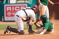 Catcher Matt Watson #24 of the Boston College Eagles puts the tag on Stephen Perez #4 of the Miami Hurricanes to end the top of the 12th inning during Game 4 at the 2010 ACC Baseball Tournament at NewBridge Bank Park May 27, 2010, in Greensboro, North Carolina.  The Eagles defeated the Hurricanes 12-10 in 10 innings.  Photo by Brian Westerholt / Four Seam Images