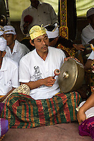 Jatiluwih, Bali, Indonesia.  A Gong Player in a Gamelan Orchestra,  Luhur Bhujangga Waisnawa Hindu Temple.