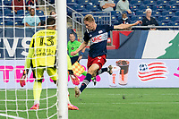 FOXBOROUGH, MA - MAY 22: Adam Buksa #9 of New England Revolution takes a shot at the New York Red Bulls goal during a game between New York Red Bulls and New England Revolution at Gillette Stadium on May 22, 2021 in Foxborough, Massachusetts.
