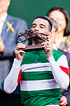 Brazilian jockey Joao Moreira who rode Neorealism celebrates with his trophy after winning the Audemars Piguet QEII Cup horse race at Sha Tin race course in Hong Kong, China. (Photo by Marcio Rodrigo Machado / Power Sport Images)