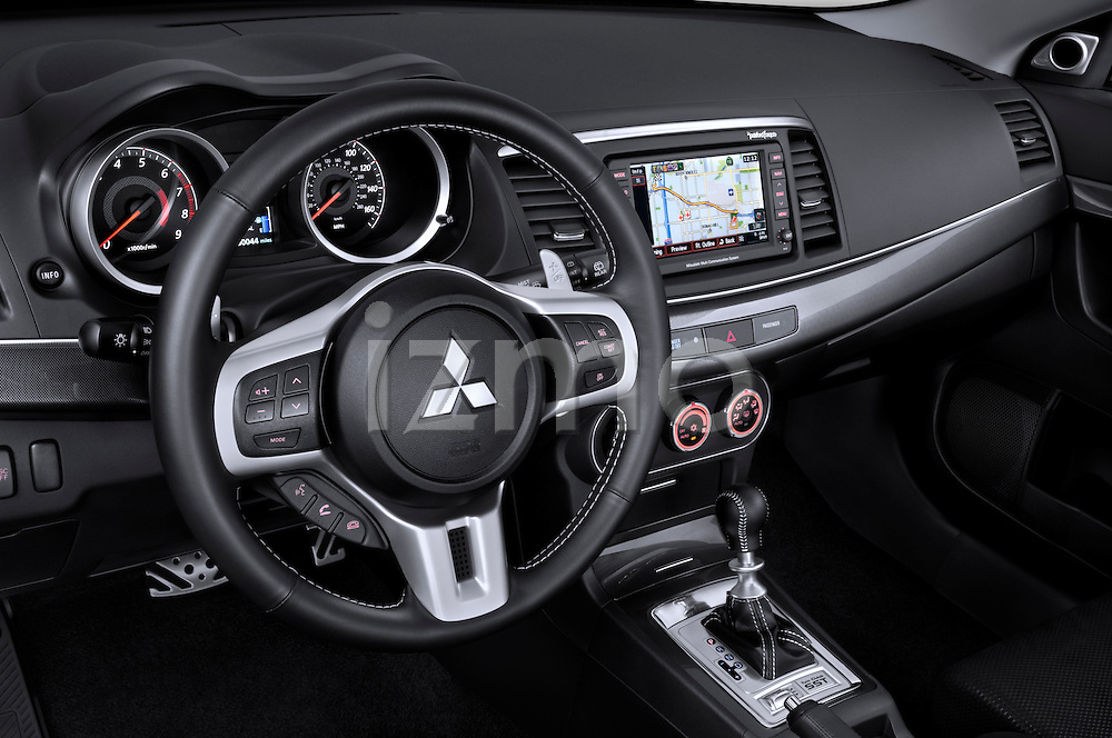 Straight dashboard view of a 2010 Mitsubishi Lancer Sportback.