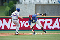 Frisco RoughRiders second baseman Charles Leblanc (12) bare hands a ball Luis Barrera (22) gets back to the bag as during a Texas League game against the Midland RockHounds on May 21, 2019 at Dr Pepper Ballpark in Frisco, Texas.  (Mike Augustin/Four Seam Images)
