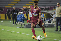 IBAGUE - COLOMBIA, 30-03-2021: Yeison Angulo del Tolima en acción durante partido entre Deportes Tolima y Atlético Nacional por la fecha 16 como parte de la Liga BetPlay DIMAYOR I 2021 jugado en el estadio Manuel Murillo Toro de la ciudad de Ibagué. / Yeison Angulo of Tolima in action during match between Deportes Tolima and Atletico Nacional for the date 16 as part of BetPlay DIMAYOR League I 2021 played at Manuel Murillo Toro stadium in Ibague. Photo: VizzorImage / Juan Torres / Cont