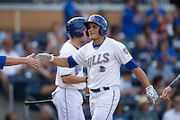 Mikie Mahtook (7) of the Durham Bulls high slaps hands with a teammate after hitting a home run against the Louisville Bats at Durham Bulls Athletic Park on August 9, 2015 in Durham, North Carolina.  The Bulls defeated the Bats 9-0.  (Brian Westerholt/Four Seam Images)