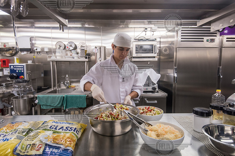 Dmitri Obrazkov preparing salad for the crew's dinner on the ice breaking and supply ship 'Fedor Ushakov' during its voyage along the Northern Sea Route.
