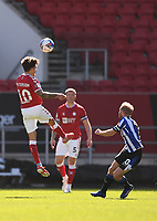 27th September 2020; Ashton Gate Stadium, Bristol, England; English Football League Championship Football, Bristol City versus Sheffield Wednesday; Jamie Paterson of Bristol City heads away to clear the danger