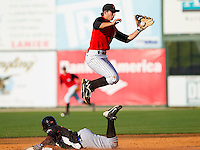Second baseman Ross Wilson #2 of the Kannapolis Intimidators leaps for a high throw as Odubel Herrera #2 of the Hickory Crawdads steals second base at Fieldcrest Cannon Stadium on April 17, 2011 in Kannapolis, North Carolina.   Photo by Brian Westerholt / Four Seam Images