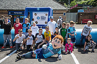 Bodger poses with children during the Wycombe Wanderers 2016/17 Kit launch to the Public at Adams Park, High Wycombe, England on 10 July 2016. Photo by Andy Rowland.