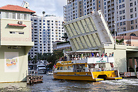 Ft. Lauderdale, Florida.  Double-decker Water Taxi  Passing under the SE 3rd. Avenue Drawbridge on New River.